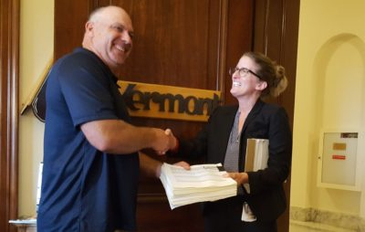 Contract poultry grower, Eric Hedrick, delivering petitions to members of Congress